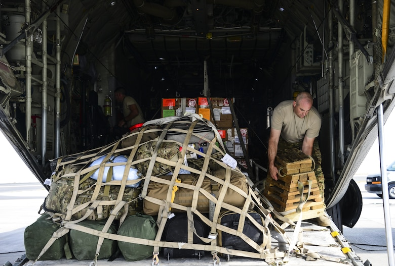 Master Sgt. Paul Serafini, 746th Expeditionary Airlift Squadron loadmaster, secures a milk stool ramp support platform and straps down a cargo load on a C-130 Hercules prior to take off June 28, 2016, at Al Udeid Air Base, Qatar. C-130 maintainers and operations group from the 914th Airlift Wing out of Niagara Falls Air Reserve Station, N.Y. have deployed here since 2005 to support the U.S. Air Forces Central Command's mission. (U.S. Air Force photo/Senior Airman Janelle Patiño/Released)