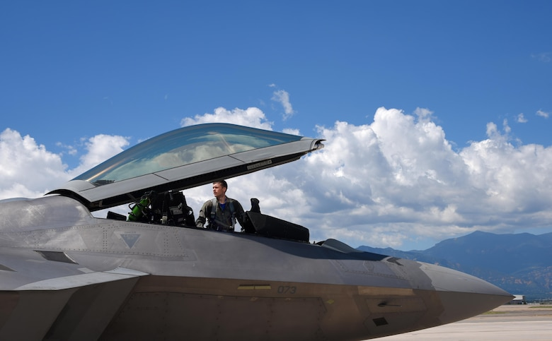 Capt. Michael Broch, a 94th Fighter Squadron F-22A Raptor aircraft commander, performs his preflight inspection at Peterson Air Force Base, Colo., Aug. 12, 2016. Assigned to the 94th FS at Langley AFB, Va., the Raptor landed at Peterson AFB to refuel as Broch and the aircraft fly back to Virginia. (U.S. Air Force photo/Airman 1st Class Dennis Hoffman)