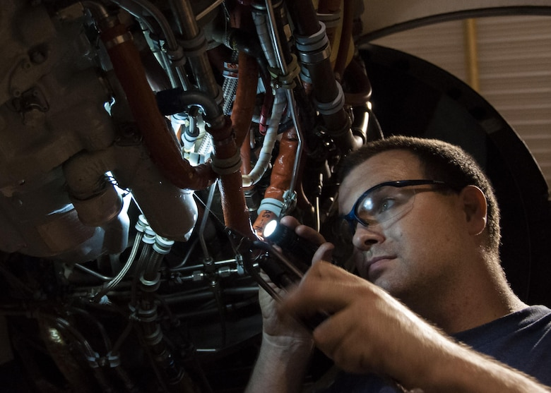 Tech. Sgt. Russell Roberts, a crew chief with the 442nd Maintenance Squadron, attaches a new integrated drive generator to the engine of an A-10 Thunderbolt II at Whiteman Air Force Base, Mo., Aug. 15, 2016. The maintenance crew found debris in the sight glass of the previous IDG, which caused the engine to lose power. (U.S. Air Force photo/Senior Airman Missy Sterling)