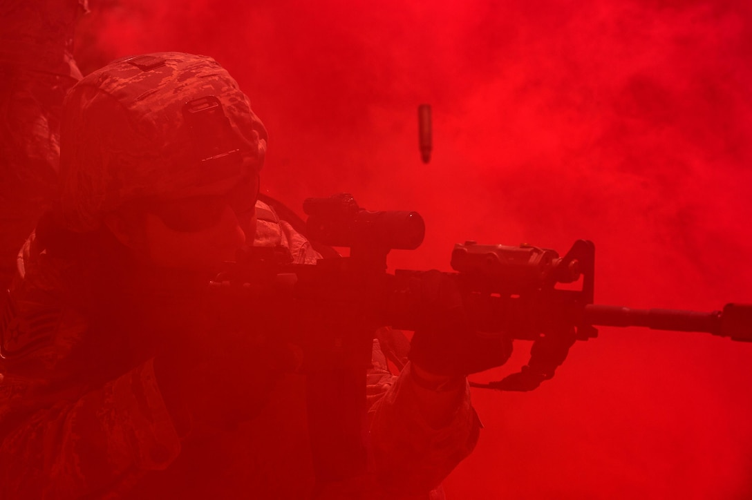 Staff Sgt. Courtney McClellan, of the 137th Security Forces Squadron, returns fire during a simulated urban terrain exercise at Camp Gruber Training Center near Braggs, Okla., Aug. 3, 2016. Approximately 40 members of the 137th SFS completed annual training from July 29 to Aug. 5. Airmen engaged in extensive training exercises including close combat training, weapons training, military operations on urban terrain and navigation training. (U.S. Air National Guard photo/Senior Airman Tyler Woodward)
