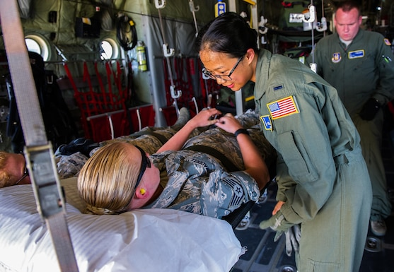 U.S. Air Force 1st Lt. April Telan, a flight nurse from the 446th Aeromedical Evacuation Squadron, Joint Base Lewis-McChord, Wash., prepares a simulated patient for transport on a C-130 Hercules as part of a simulated aeromedical evacuation at Tactical Assembly Area Young, Fort McCoy, Wis., August 15, 2016, during exercise Patriot Warrior. Patriot Warrior is the Air Force Reserve's premier contingency deployment training exercise, designed to demonstrate training ranging from bare base buildup to full operational capabilities. More than 11,000 members from the U.S. service branches and their Reserve components, including Air Force, Army, Navy, and Marines are participating alongside British, Canadian, and Saudi Arabian forces. (U.S. Air Force photo by Airman 1st Class Christopher Dyer)