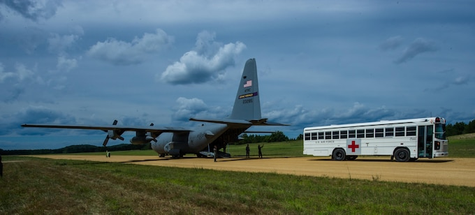 U.S. Airmen practice transferring patients from a bus to a C-130 Hercules as part of a simulated aeromedical evacuation at Tactical Assembly Area Young, Fort McCoy, Wis., August 15, 2016, during exercise Patriot Warrior. Patriot Warrior is the Air Force Reserve's premier contingency deployment training exercise, designed to demonstrate training ranging from bare base buildup to full operational capabilities. More than 11,000 members from the U.S. service branches and their Reserve components, including Air Force, Army, Navy, and Marines are participating alongside British, Canadian, and Saudi Arabian forces. (U.S. Air Force photo by Airman 1st Class Christopher Dyer)