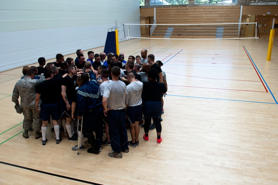 Saber Airmen gather for a chant after a volleyball game between Spangdahlem's ALS students and Saber senior NCOs at the Eifel Powerhouse on Spangdahlem Air Base, Germany, Aug. 17, 2016. The event marked the second time students at Spangdahlem defeated senior NCOs in the past 21 games.
