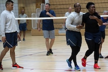 U.S. Air Force Senior Airman Nathan Little, right center, and Senior Airman Tonyea Jackson, right, both Airman Leadership School students, laugh with each other after a collision during a volleyball game at the Eifel Powerhouse on Spangdahlem Air Base, Germany, Aug. 17, 2016. Traditionally, Saber senior NCOs challenge ALS students at Spangdahlem to compete in a volleyball match in a friendly rivalry game.