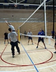 U.S. Air Force Senior Airman Randall Saylor, Airman Leadership School student, top left, prepares to spike a volleyball during a volleyball game at the Eifel Powerhouse on Spangdahlem Air Base, Germany, Aug. 17, 2016. Traditionally, Saber senior NCOs challenge ALS students at Spangdahlem to compete in a volleyball match in a friendly rivalry game.