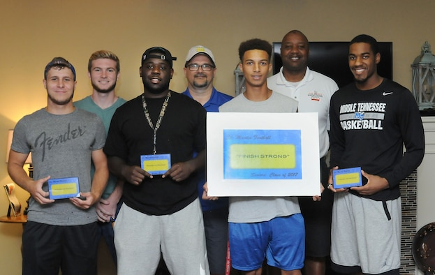 Keesler personnel take a photo with St. Martin High School senior football players during a leadership seminar Aug. 13, 2016, at Center Pointe Church in Ocean Springs, Miss. The seminar was a collaboration of the St. Martin Gridiron Club and Keesler personnel who demonstrated the value of being better leaders by adopting good attitudes, values, beliefs and teamwork to the students.  (Courtesy photo/Kemberly Groue)