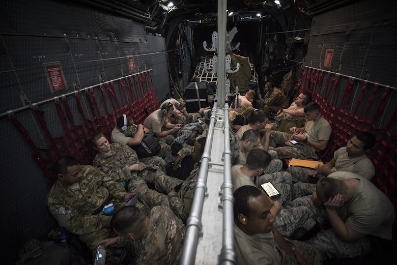 Air Commandos sit inside an MC-130H Combat Talon II en-route to Wright Patterson Air Force Base, Ohio, Aug. 15, 2016. Airmen with the 1st Special Operations Wing traveled to Wright Patterson AFB for Task Force Exercise Olympus Archer. Olympus Archer will maximize training opportunities for more than 230 Air Commandos, with an emphasis on medical and flying operations. (U.S. Air Force photo by Staff Sgt. Christopher Callaway)