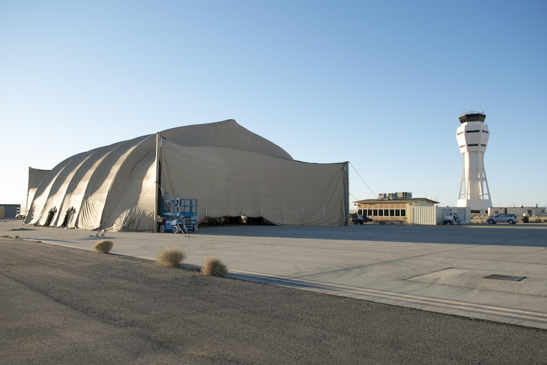 Members of the 461st Flight Test Squadron and Joint Strike Fighter Integrated Test Force have built a decontamination shelter on the flightline to conduct chemical and biological decontamination tests on the F-35 Lightning II. Tests will be toward the end of August. (U.S. Air Force photo by Brad White)