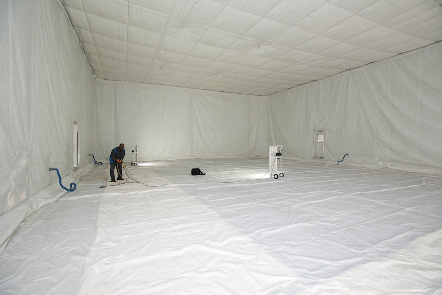 After four weeks, the decontamination shelter is nearing completion and decontamination tests will begin on an F-35A toward the end of August. The inner structure is insulated with heat absorbing panels and a liner to keep high heat inside to decontaminate the jet. (U.S. Air Force photo by Brad White)