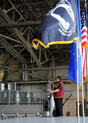 "The POW/MIA flag waves in the wind as Capt. William ""Bill"" Robinson, United States Air Force retired, speaks with Airmen August 18, 2016, on Grand Forks Air Force Base, N.D. Robinson spent nearly eight years as a POW in Vietnam, which is the longest time spent as a POW by any enlisted member. (U.S. Air Force photo by Senior Airman Ryan Sparks/Released)"