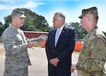 Defense Logistics Agency Aviation and Defense Supply Center Richmond Commander, Air Force Brig. Gen. Allan Day greets Virginia Governor Terry McAuliffe and the Adjutant General of Virginia, Maj. Gen. Timothy Williams to the installation for a ground-breaking ceremony August 17. The Virginia National Guard is set to build a 102,000 square-foot facility on the north side of DSCR. The $30 million project will serve as the National Guard state headquarters.