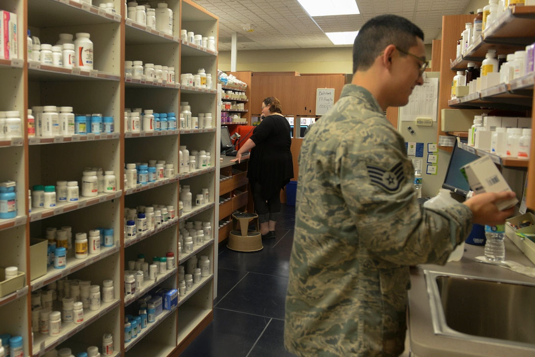 Pharmacists complete on-duty tasks at Minot Air Force Base, N.D., Aug. 17, 2016. Pharmacists provide prescriptions to all active duty military, to include personnel reliability program and arming and use-of-force Airmen. (U.S Air Force photo/Airman 1st Class Jessica Weissman)