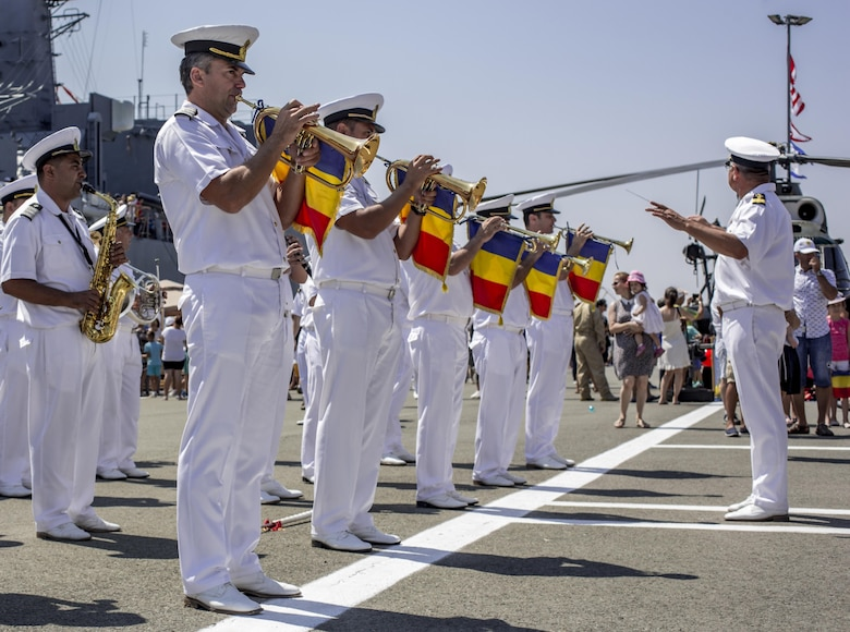 The Romanian Navy Band perform for Romanian citizens, U.S. Marines from the Black Sea Rotational Force, and U.S. soldiers stationed at Mihail Kogălniceanu Air Base on Open Gates Day at the Naval Port of Constanța, Romania, Aug. 6, 2016. Black Sea Rotational Force is an annual multilateral security cooperation activity between the U.S. Marine Corps and partner nations in the Black Sea, Balkan and Caucasus regions designed to enhance participants' collective professional military capacity, promote regional stability and build enduring relationships with partner nations. (U.S. Marine Corps photo by Lance Cpl. Timothy J. Lutz)