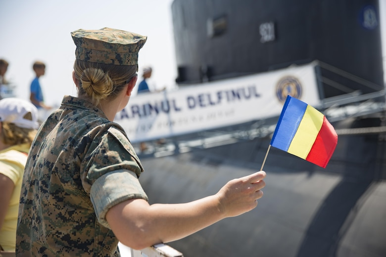 U.S. Marine Corps Cpl. Colleen Moran watches as local Romanians board a submarine during Open Gates Day during a Civilian Affairs engagement on Open Gates Day at the Naval Port of Constanța, Constanța, Romania, Aug. 6, 2016. The BSRF is an annual multilateral security cooperation activity between the U.S. Marine Corps and partner nations in the Black Sea, Balkan and Caucasus regions designed to enhance participants' collective professional military capacity, promote regional stability and build enduring relationships with partner nations. (U.S. Marine Corps photo by Cpl. Clarence L. Wimberly)