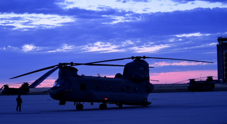 A CH-47 Chinook helicopter sits as the air crew prepares for takeoff to Denver International Airport August 17, 2016, on Buckley Air Force Base, Colo. The air crew and helicopter took part in the annual National Disaster Medical System training exercise, which included transporting patients to and from Denver hospitals. (U.S. Air Force photo by Airman 1st Class Gabrielle Spradling/Released)