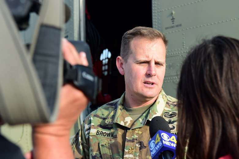 Maj. Troy Brown, Army Aviation Support Facility commander, provides media with an interview during the annual National Disaster Medical System training exercise August 17, 2016, at the Denver International Airport. The exercise brought many organizations, both military and civilian, together to ensure a cohesive relationship. (U.S. Air Force photo by Airman 1st Class Gabrielle Spradling/Released)