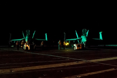 Sailors prepare to secure two F/A-18E Super Hornets to the flight deck of the aircraft carrier USS Dwight D. Eisenhower in the Persian Gulf, July 29, 2016. The Eisenhower and its carrier strike group were deployed in support of Operation Inherent Resolve, maritime security operations and theater security cooperation efforts in the U.S. 5th Fleet area of operations. Navy photo by Petty Officer 3rd Class Anderson W. Branch
