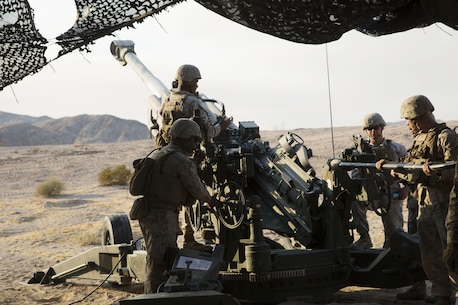 Marines with Battery I, 3rd Battalion, 12th Marine Regiment attached to 1st Battalion Regiment, 11th Marine Division prepare to fire a M777A2 Howitzer during Large Scale Exercise 2016 at Marine Corps Air-Ground Combat Center Twentynine Palms, Calif., Aug. 16, 2016. LSE-16 simulates the planning, deployment and combat operations of a cohesive, combat-ready team consisting of more than 50,000 military members with I Marine Expeditionary Force. (U.S. Marine Corps photo by Sgt. Abbey Perria)