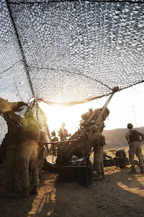 Marines with Battery I, 3rd Battalion, 12th Marine Regiment attached to 1st Battalion Regiment, 11th Marine Division load amunition into a M777A2 Howitzer during Large Scale Exercise 2016 at Marine Corps Air-Ground Combat Center Twentynine Palms, Calif., Aug. 16, 2016. LSE-16 simulates the planning, deployment and combat operations of a cohesive, combat-ready team consisting of more than 50,000 military members with I Marine Expeditionary Force. (U.S. Marine Corps photo by Sgt. Abbey Perria)