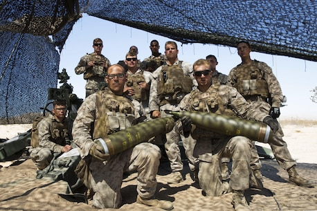 Marines with Battery I, 3rd Battalion, 12th Marine Regiment attached to 1st Battalion Regiment, 11th Marine Division pose in front of a M777A2 Howitzer during Large Scale Exercise 2016 at Marine Corps Air-Ground Combat Center Twentynine Palms, Calif., Aug. 16, 2016. LSE-16 simulates the planning, deployment and combat operations of a cohesive, combat-ready team consisting of more than 50,000 military members with I Marine Expeditionary Force. (U.S. Marine Corps photo by Sgt. Abbey Perria)