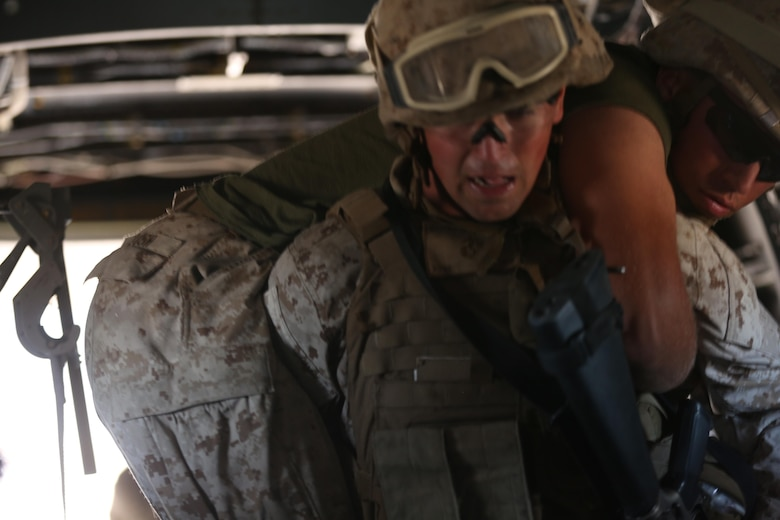 A Marine with 5th Battalion, 11th Marine Regiment, loads a simulated casualty onto an MV-22B Osprey during a casualty evacuation exercise aboard Marine Corps Base Camp Pendleton, Calif., Aug. 17. Marine Medium Tiltrotor Squadron (VMM) 161 supported 5th Battalion, 11th Marines, in order to increase proficiency in conducting CAS EVACS. (U.S. Marine Corps photo by Pfc. Jake M. T. McClung/Released)