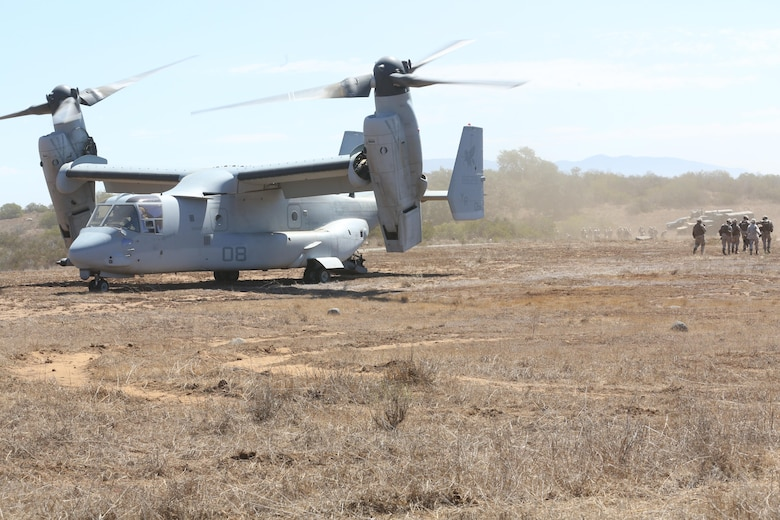Marines from 5th Battalion, 11th Marine Regiment, walk away from an MV-22B Osprey during a casualty evacuation exercise aboard Marine Corps Base Camp Pendleton, Calif., Aug. 17. Marine Medium Tiltrotor Squadron 161 supported 5th Battalion, 11th Marines, in order to increase proficiency in conducting CAS EVACS. (U.S. Marine Corps photo by Pfc. Jake M. T. McClung/Released)