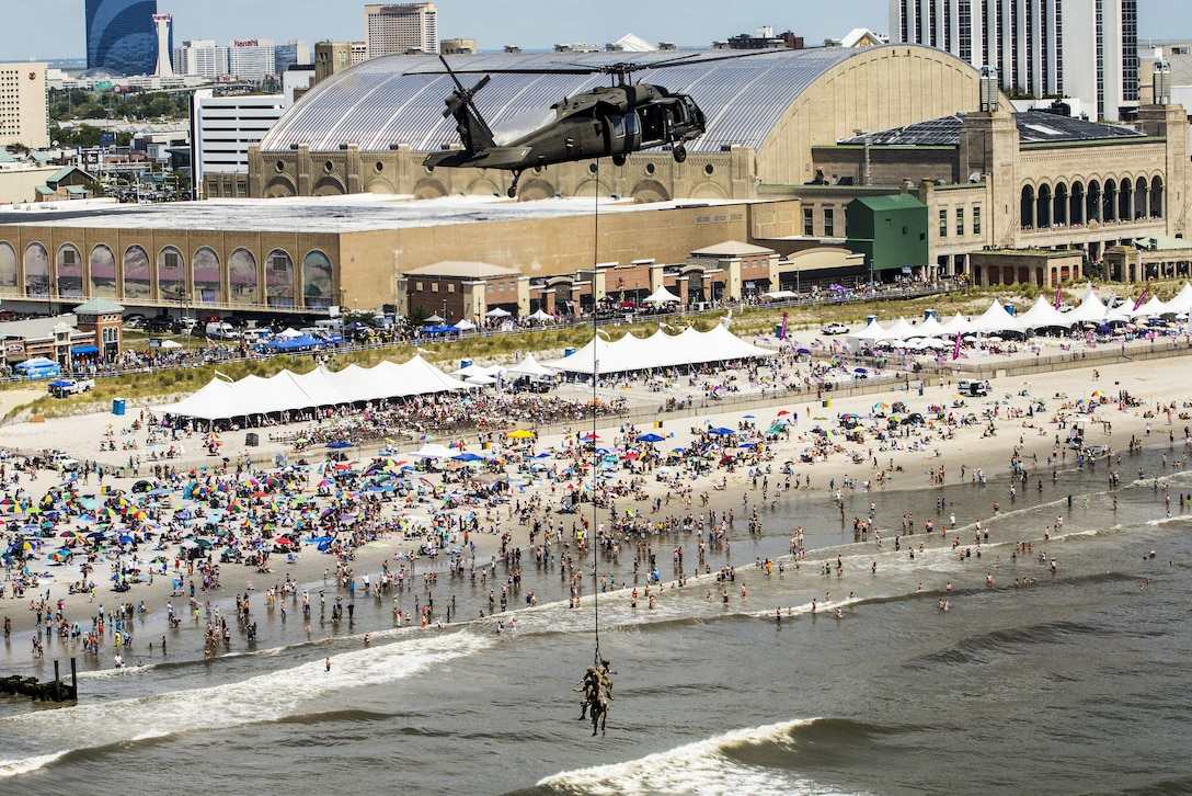 A UH-60 Black Hawk helicopter and airmen demonstrate insertion and extraction techniques at the 2016 Atlantic City Airshow over the boardwalk in Atlantic City, N.J., Aug. 17, 2016. The airmen are assigned to the New Jersey Air National Guard's 227th Air Support Operations Squadron and the Black Hawk is assigned to the New Jersey Army National Guard's 1st Battalion, 150th Assault Helicopter Regiment. Air National Guard photo by Master Sgt. Mark C. Olsen