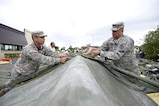 U.S. Army Spc. Dwight Chavez (left), 228th Combat Support Hospital preventive medicine specialist, and Sgt. Randy Sanchez (right), 228th CSH healthcare sergeant, construct a tent in support of a medical exercise being held at Misawa Air Base, Japan, Aug. 18, 2016. The 228th CSH will be conducting joint exercises over the course of a week with the 35th Medical Group from Misawa AB.