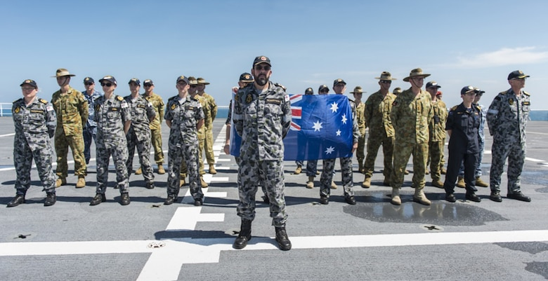 Australian and New Zealand service members stand in formation to honor the wreckage of modified Leander-class light cruiser HMAS Perth (D29) and Northampton-class cruiser USS Houston (CA 30) as hospital ship USNS Mercy (T-AH 19) passes, Aug. 17, 2016.  Both ships sank March 1, 1942, during the World War II Battle of Sunda Strait. Mercy is sailing to the final mission stop of Pacific Partnership 2016 in Padang, Indonesia. Upon arrival, partner nations will work side-by-side with local military and non-government organizations to conduct cooperative health engagements, community relation events, subject matter expert exchanges and a SAR exercise to better prepare for a natural disaster or crisis.