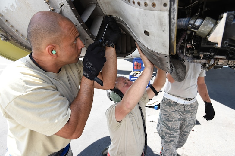 Master Sgt. Omar Torres, left, from the 513th Maintenance Squadron, and Staff Sgt. Austin Paisley, right, from the 552nd Aircraft Maintenance Squadron, remove an engine part from an E-3 Sentry on July 25, 2016, at Joint Base Pearl Harbor-Hickam, Hawaii. More than 125 Airmen from the 513th Air Control Group and 552nd Air Control Wing are deployed to Hawaii in support of the Rim of the Pacific 2016 exercise. Twenty-six nations, more than 40 ships and submarines, more than 200 aircraft and 25,000 personnel are participating in RIMPAC from June 30 to Aug. 4, in and around the Hawaiian Islands and Southern California. The world's largest international maritime exercise, RIMPAC provides a unique training opportunity that helps participants foster and sustain the cooperative relationships that are critical to ensuring the safety of sea lanes and security on the world's oceans. RIMPAC 2016 is the 25th exercise in the series that began in 1971. (U.S. Air Force photo by 2nd Lt. Caleb Wanzer)