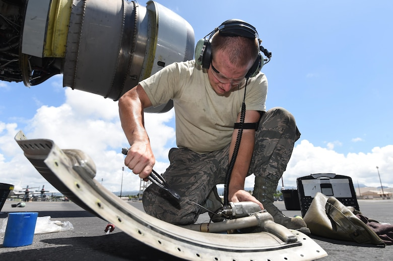 Staff Sgt. Austin Paisley, assigned to the 552nd Aircraft Maintenance Squadron, prepares an engine part for an E-3 Sentry on July 25, 2016, at Joint Base Pearl Harbor-Hickam, Hawaii. More than 125 Airmen from the 513th Air Control Group and 552nd Air Control Wing are deployed to Hawaii in support of the Rim of the Pacific 2016 exercise. Twenty-six nations, more than 40 ships and submarines, more than 200 aircraft and 25,000 personnel are participating in RIMPAC from June 30 to Aug. 4, in and around the Hawaiian Islands and Southern California. The world's largest international maritime exercise, RIMPAC provides a unique training opportunity that helps participants foster and sustain the cooperative relationships that are critical to ensuring the safety of sea lanes and security on the world's oceans. RIMPAC 2016 is the 25th exercise in the series that began in 1971. (U.S. Air Force photo by 2nd Lt. Caleb Wanzer)