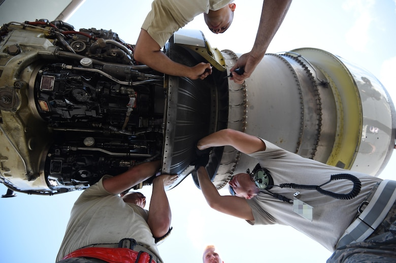 Maintenance Airmen from the 513th Air Control Group and 552nd Air Control Wing replace an engine part on an E-3 Sentry on July 25, 2016, at Joint Base Pearl Harbor-Hickam, Hawaii. More than 125 Airmen from the 513th Air Control Group and 552nd Air Control Wing are deployed to Hawaii in support of the Rim of the Pacific 2016 exercise. Twenty-six nations, more than 40 ships and submarines, more than 200 aircraft and 25,000 personnel are participating in RIMPAC from June 30 to Aug. 4, in and around the Hawaiian Islands and Southern California. The world's largest international maritime exercise, RIMPAC provides a unique training opportunity that helps participants foster and sustain the cooperative relationships that are critical to ensuring the safety of sea lanes and security on the world's oceans. RIMPAC 2016 is the 25th exercise in the series that began in 1971. (U.S. Air Force photo by 2nd Lt. Caleb Wanzer)