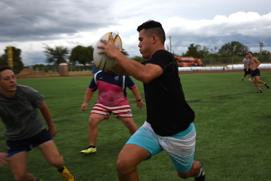 Rugby club members compete against each other during practice on the base softball field on Goodfellow Air Force Base, Texas, Aug. 17, 2016. In order to keep the players from being injured, the practice games are played by two-hand touches to simulate a tackle. (U.S. Air Force photo by Airman 1st Class Caelynn Ferguson/Released)
