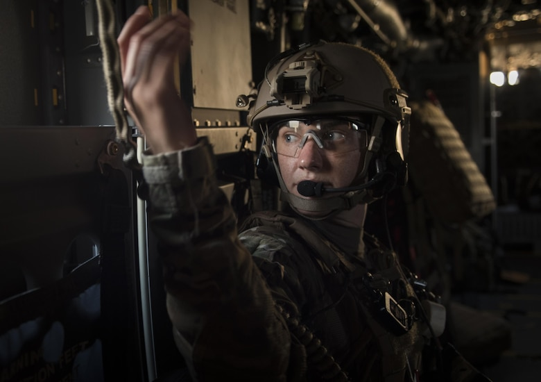 Capt. Casey Fox, a flight physician assistant with the 1st Special Operations Medical Group, looks out a window on-board a CV-22 Osprey during Task Force Exercise Olympus Archer at Wright Patterson Air Force Base, Ohio, Aug. 18, 2016. Olympus Archer focuses on maximizing training opportunities for more than 230 Air Commandos, with the 1st Special Operations Wing, emphasizing on medical operations in conjunction with flying operations. (U.S. Air Force photo by Staff Sgt. Christopher Callaway)