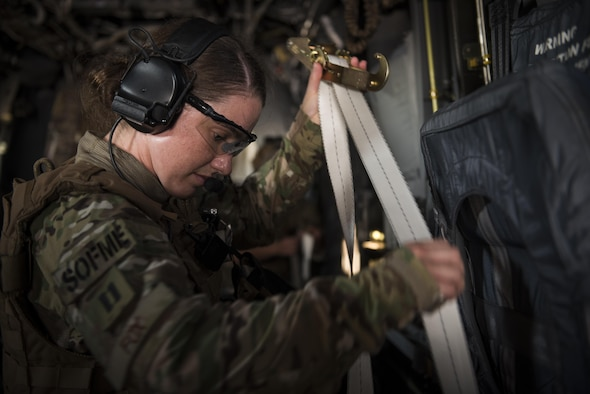 Capt. Casey Fox, a flight physician assistant with the 1st Special Operations Medical Group, straps down a litter during Task Force Exercise Olympus Archer at Wright Patterson Air Force Base, Ohio, Aug. 18, 2016.  Olympus Archer focuses on maximizing training opportunities for more than 230 Air Commandos, with the 1st Special Operations Wing, emphasizing on medical operations in conjunction with flying operations. (U.S. Air Force photo by Staff Sgt. Christopher Callaway)