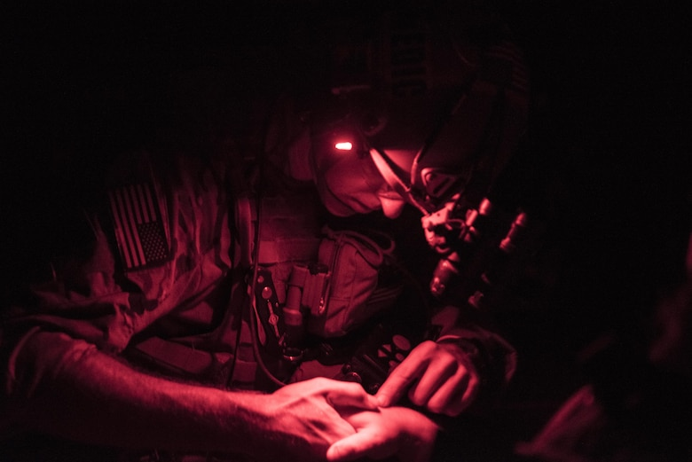 Capt. Aaron Thomas, a flight surgeon with the 1st Special Operations Medical Group, examines a patient's arm during Task Force Exercise Olympus Archer at Wright Patterson Air Force Base, Ohio, Aug. 18, 2016. Olympus Archer focuses on maximizing training opportunities for more than 230 Air Commandos, with the 1st Special Operations Wing, emphasizing on medical operations in conjunction with flying operations. (U.S. Air Force photo by Staff Sgt. Christopher Callaway)