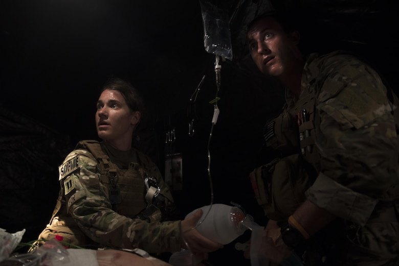 Capt. Casey Fox, a flight physician assistant with the 1st Special Operations Medical Group, left, and Capt. Aaron Thomas, a flight surgeon with the 1st SOMDG, provide medical care to a patient during Task Force Exercise Olympus Archer at Wright Patterson Air Force Base, Ohio, Aug. 18, 2016. Olympus Archer focuses on maximizing training opportunities for more than 230 Air Commandos, with the 1st Special Operations Wing, emphasizing on medical operations in conjunction with flying operations. (U.S. Air Force photo by Staff Sgt. Christopher Callaway)
