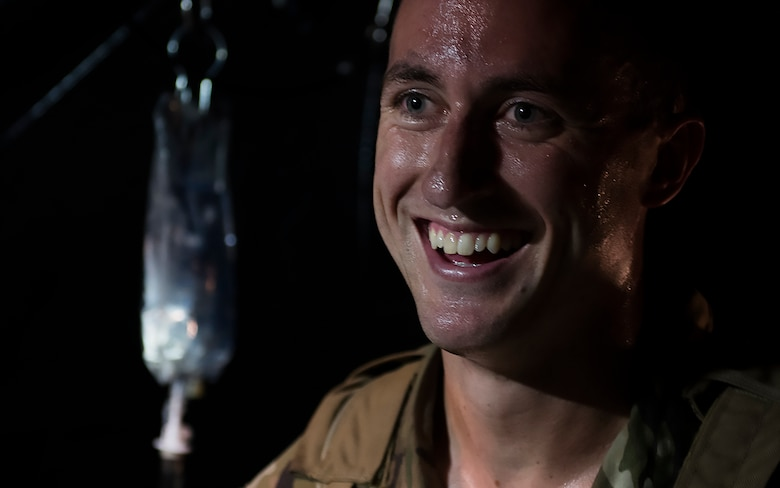 Capt. Aaron Thomas, a flight surgeon with the 1st Special Operations Medical Group, smiles after completing care on a patient during Task Force Exercise Olympus Archer at Wright Patterson Air Force Base, Ohio, Aug. 18, 2016. Olympus Archer focuses on maximizing training opportunities for more than 230 Air Commandos, with the 1st Special Operations Wing, emphasizing on medical operations in conjunction with flying operations. (U.S. Air Force photo by Staff Sgt. Christopher Callaway)