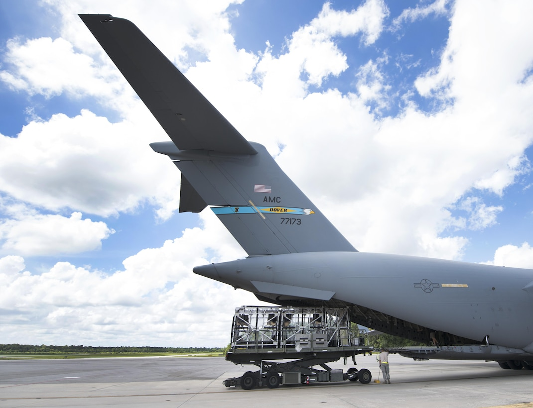 """A Transportation Isolation System (TIS) is loaded onto a C-17 Globemaster III aircraft during Exercise Mobilty Solace at Joint Base Charleston, S.C., Aug. 15, 2016. Mobility Solace provides Air Mobility Command, working with joint partners, the opportunity to evaluate the protocols and operational sequences of moving multiple patients exposed or infected with Ebola using the TIS, while also minimizing the risks to aircrew, medical attendants and the airframe. The TIS is a modular, scalable system, composed of at least one isolation pallet for patient transportation and care, one pallet configured as an """"antechamber"""" to provide medical members with an enclosed space to safely decontaminate and remove their personal protective equipment before exiting. (U.S. Air Force Photo/Airman Megan Munoz)"""