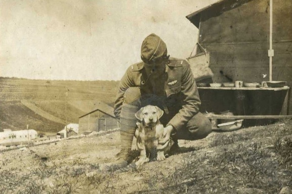 U.S. Army Air Corps 1st Lt. John Fairall kneels with the first mascot of the 88th Aero Squadron, Wrinkles. The 88th AS would eventually go on to become the 436th Training Squadron, celebrating 99 years of service Aug. 17, 2016.  (U.S. Air Force courtesy photo)