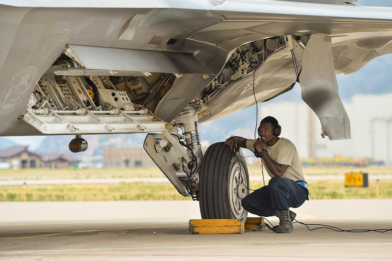 Senior Airman Isaiah Williams, a crew chief assigned to 95th Aircraft Maintenance Unit, Tyndall Air Force Base, Fla., performs final checks before launching an F-22 Raptor aircraft during exercise Combat Archer at Hill Air Force Base, Utah, Aug. 18, 2016. (U.S. Air Force photo by R. Nial Bradshaw)
