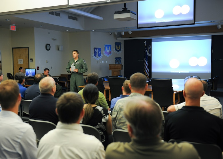 Col. Michael Smith, 174th Attack Wing commander, briefs local employers on the missions and capabilities of the wing, during an Employer Support of the Guard and Reserve (ESGR) Boss Day event on Hancock Field, Thursday, August 18. ESGR is a Department of Defense program established in 1972 to encourage cooperation between Reserve Component Service members and their employers. ESGR events like the Boss Day allow employers to see what their employees take part in as part of their military commitment. (U.S. Air National Guard photo by Tech. Sgt. Jeremy M. Call/Released)