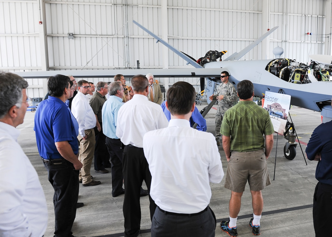 Local employers receive a briefing on the MQ-9 Remotely Piloted Aircraft, during an Employer Support of the Guard and Reserve (ESGR) Boss Day event on Hancock Field, Thursday, August 18. ESGR is a Department of Defense program established in 1972 to encourage cooperation between Reserve Component Service members and their employers. Boss Day events allow employers to see what their employees take part in as part of their military commitment. (U.S. Air National Guard photo by Tech. Sgt. Jeremy M. Call/Released)