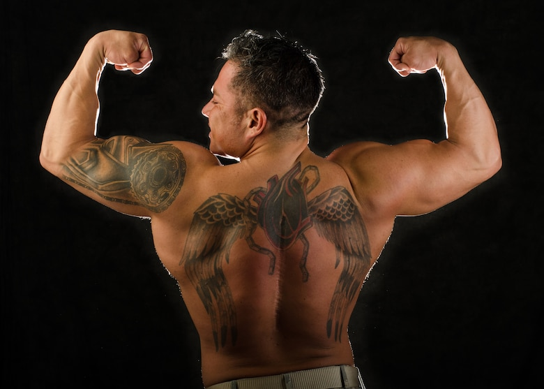 Tech. Sgt. Ricardo Zuniga, weapons load team chief with the 131st Aircraft Maintenance Squadron, won the first Whiteman Classic bodybuilding event in Sedalia, Missouri, in Nov. 2015. Zuniga's tattoo partially covers the scar from multiple back surgeries after a motorcycle accident forced him to relearn to walk and take better care of his physical condition. (U.S. Air National Guard photo by Airman 1st Class Halley Burgess)