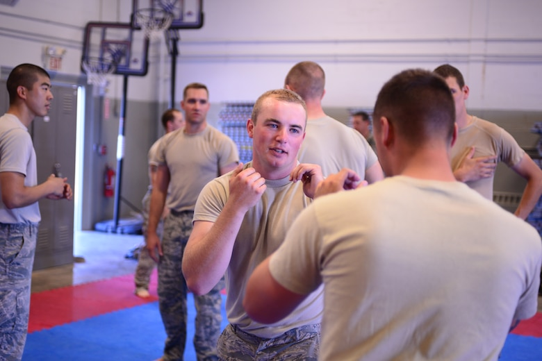 U.S. Air Force Senior Airman Brandan Able, with the 157th Security Forces Squadron, New Hampshire Air National Guard, prepares to defend himself during combative training, Aug. 3, 2016, at the New Hampshire National Guard Training Site, Center Strafford, N.H.  (Air National Guard photo by Airman 1st Class Ashlyn J. Correia)