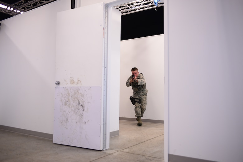 U.S. Air Force Senior Airman Kraig Hoag, with the 157th Security Forces Squadron, New Hampshire Air National Guard, clears a room inside a shoot house simulator during skills training, Aug. 3, 2016, at the New Hampshire National Guard Training Site, Center Strafford, N.H. (Air National Guard photo by Airman 1st Class Ashlyn J. Correia)