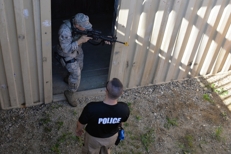 Rochester Police Sgt. Randy Smith, Assistant Team leader for the Strafford County Regional Tactical Operations Unit, instructs U.S. Air Force Senior Airman Brandan Able, with the 157th Security Forces Squadron, New Hampshire Air National Guard, on proper room clearing technique as part of skills training, Aug. 4, 2016, at the New Hampshire National Guard Training Site, Center Strafford, N.H. Members of the tactical operations unit taught the Guardsmen SWAT skills that can be used in a variety of situations. . (Air National Guard photo by Airman 1st Class Ashlyn J. Correia)