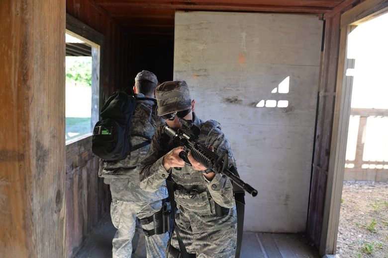 U.S. Air Force Airman 1st Class Dalton Briggs, and his partner Staff Sgt. Michael Hanes, both with the 157th Security Forces Squadron, New Hampshire Air National Guard, clear a room during skills training, Aug. 3, 2016, at the New Hampshire National Guard Training Site, Center Strafford, N.H. (Air National Guard photo by Airman 1st Class Ashlyn J. Correia)