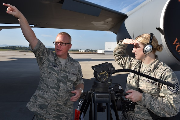 Master Sgt. Bill Conner, instructor, talks about camera shots during the Smoky Short Course in broadcasting with Tech. Sgt. Mary Thach, photojournalist assigned to the Nebraska Air National Guard, August 17, 2016, on the flight line at McGhee Tyson Air National Guard Base in Louisville, Tenn. (U.S. Air National Guard photo by Master Sgt. Mike R. Smith)