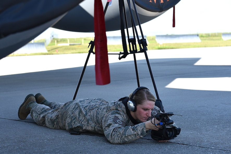 Tech. Sgt. Mary Thach, a photojournalist assigned to the Nebraska Air National Guard, 155th Air Refueling Wing, records video from a low position during the Smoky Short Course in broadcasting August 17, 2016, on the flight line at McGhee Tyson Air National Guard Base in Louisville, Tenn. (U.S. Air National Guard photo by Master Sgt. Mike R. Smith)